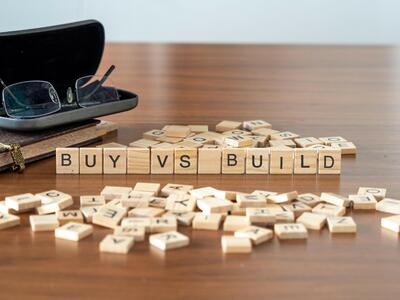 Tiles that spell Buy vs. Build.