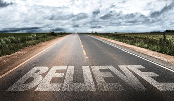 Believe written on rural road