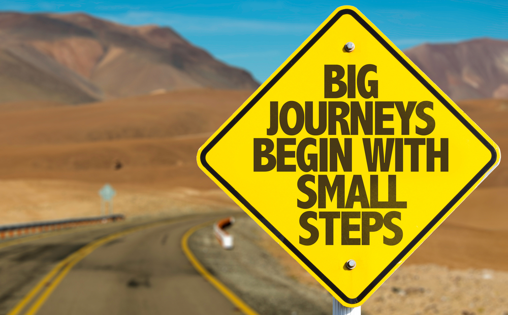 Big Journeys Begin With Small Steps sign on desert road.jpeg
