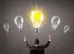Business person having an bright idea light bulb concept.jpeg
