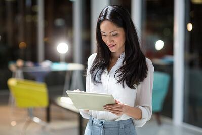 Businesswoman using digital tablet in the office