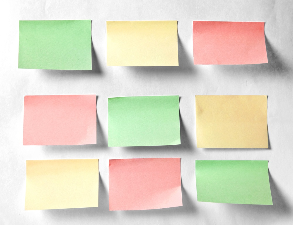 Colourful sticky notes on a white wall.jpeg