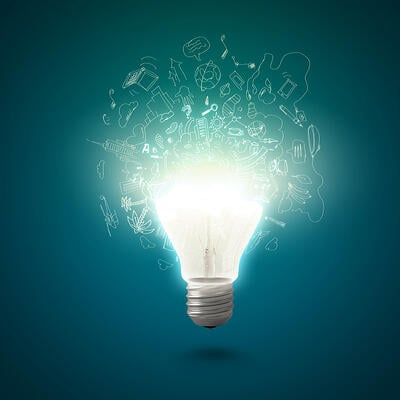 Conceptual image of electric bulb with business sketches