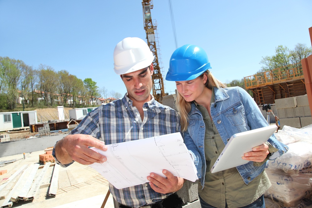 Engineers on construction site with plan.jpeg