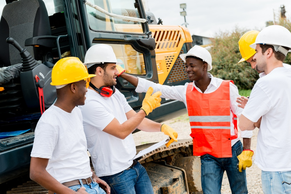Group of workers talking at a building site .jpeg