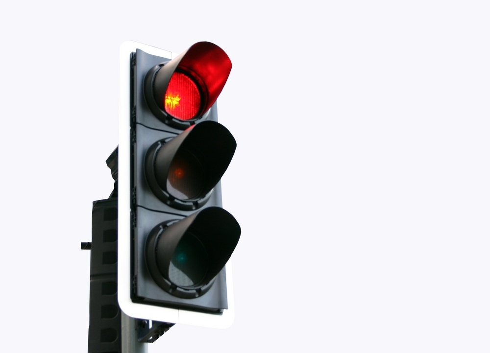 Isolated red traffic light
