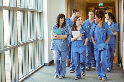 Medical students walking through corridor at the university