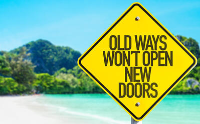 Old Ways Wont Open New Doors sign with beach background