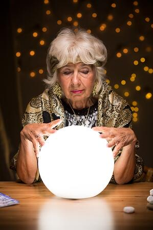 Old fortune teller sees a future from the crystal ball.jpeg