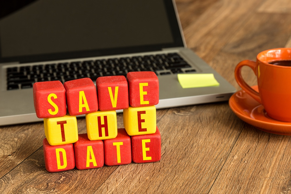 Save the Date on a wood cube in a corporate background-2