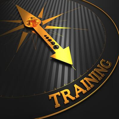 "Training - Business Background. Golden Compass Needle on a Black Field Pointing to the Word ""Training"". 3D Render."