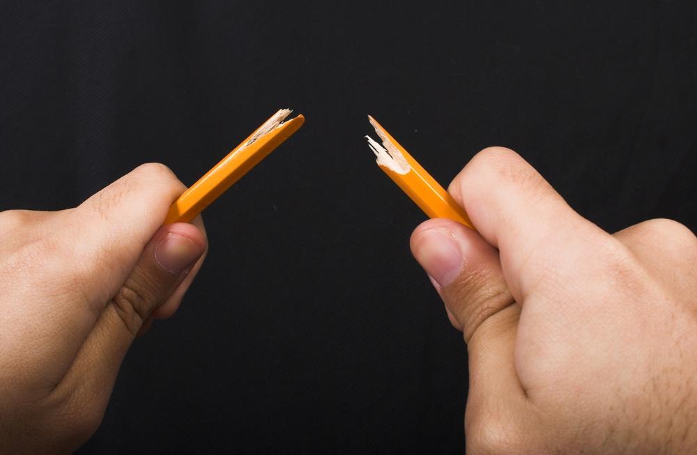 broken pencil over black
